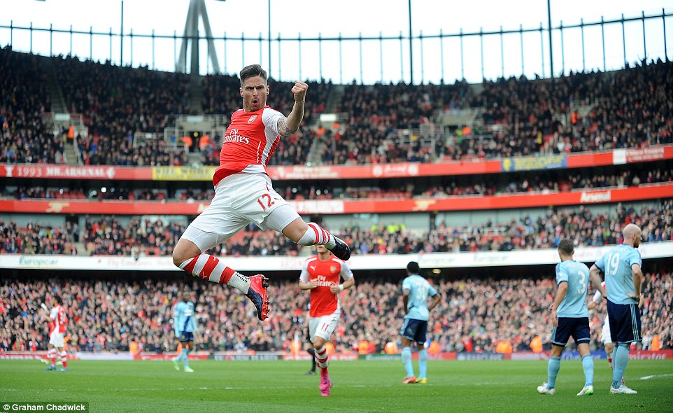 Olivier Giroud leaps in the air after opening the scoring in Arsenal's 3-0 Premier League victory over West Ham