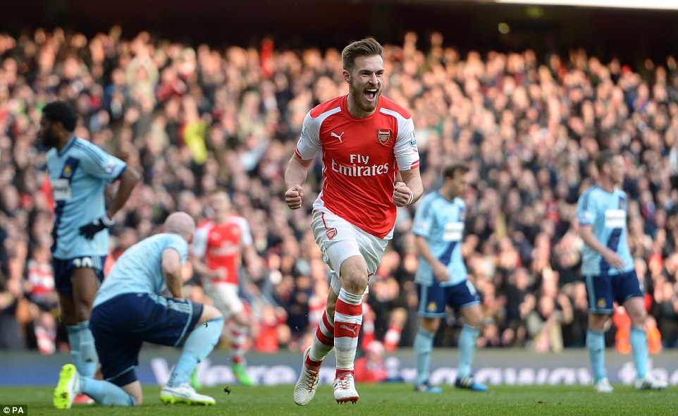 Ramsey wheels away to celebrate giving Arsenal a 2-0 lead on 81minutes of the London derby