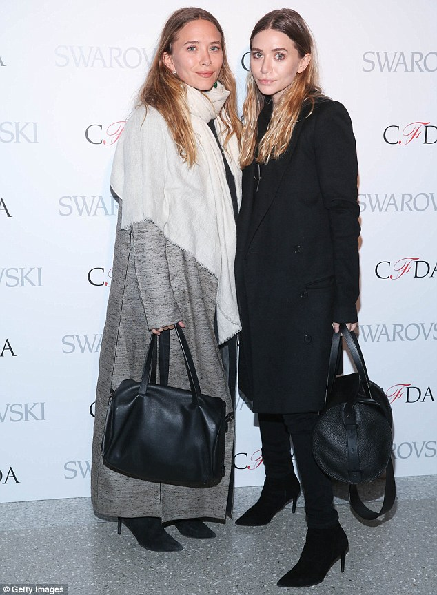 Modest moguls: Mary-Kate, left, and Ashley Olsen, right, opted to make humble appearances as they attended the 2015 CFDA Fashion Awards Announcement Party at The Weather Room at the Top of the Rock in New York City on Monday
