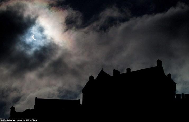 View: The eclipse over Edinburgh Castle, Scotland's capital, as it neared its peak around 9.30am