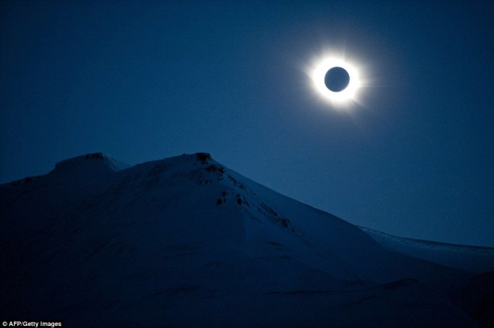 A total solar eclipse can be seen here over the mountains of Svalbard, Longyearbyen, Norway, bringing darkness to the beautiful island