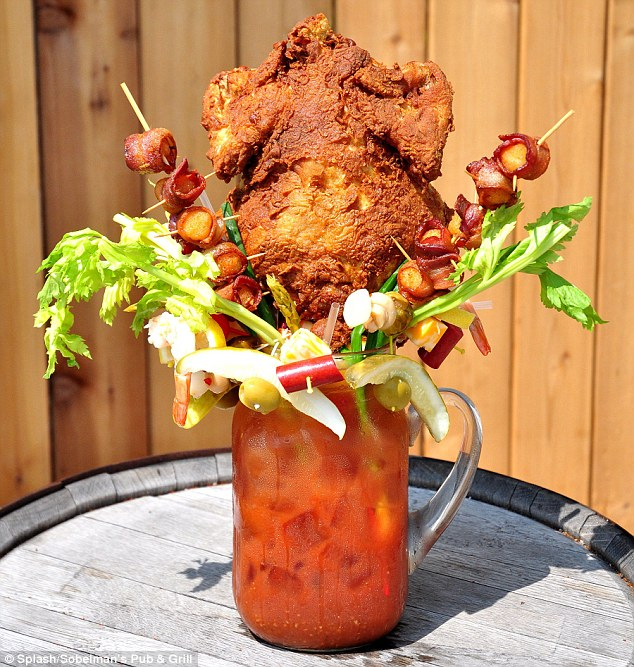 The super-size drink also comes embellished withcheese, sausage, pickles, olives, onion, mushrooms, asparagus, spring onions, shrimp, lemon, Brussels sprouts, tomato, celery and two Baconadoes