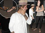 Picture Shows: Justin Bieber  March 27, 2015 <p> Freshly roasted pop star Justin Bieber enjoys a night out on the town in Los Angeles, California. The Biebs is always finding ways to show his fans how much he loves them and tonight was no exception. Justin graciously (and perhaps accidentally, jury's out on that) stepped on the bare foot of a female smoker out front of an establishment. While the moment may have been painful, she can at least take solace in the fact she'll always have the story to tell of &quot;that one night in LA when Justin Bieber like totally stepped on my foot, you guys! I can't even!&quot;.</p> <p> Non-Exclusive<br />  UK Rights Only</p> <p> Pictures by : FameFlynet UK    2015<br />  Tel : +44 (0)20 3551 5049<br />  Email : info@fameflynet.uk.com