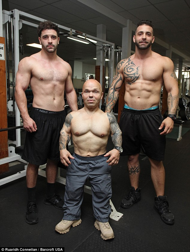 Preparing: Here he is pictured with two workout partners at a gym in Homestead, Florida, where he trains