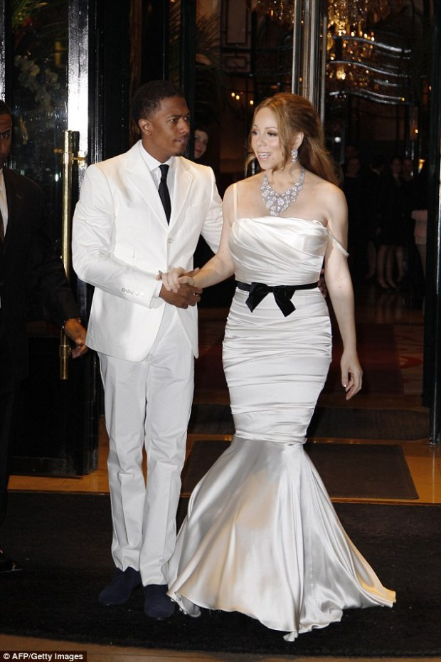 US singer Marih Carey and her husband, US movie maker and actor Nick Cannon, leave the hotel to have a dinner at the Eiffel Tower in 2012 to celebrate their fourth wedding anniversary