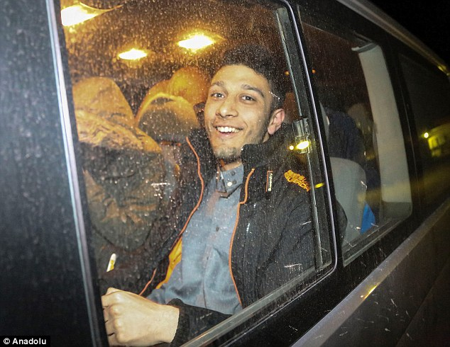 Laughing: Waheed Ahmed, 21,is said to be a member of the extremist group Hizb ut-Tahrir, which advocates a global Muslim caliphate, similar to the one established by Islamic State in Syria and Iraq
