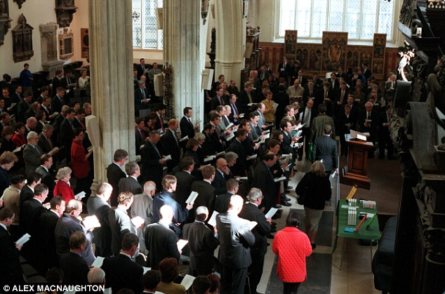 Above, a congregation of Christians in a London church.The data also revealed that the number of atheists and agnostics will decline from 16 per cent of the world's population to 13 per cent in the next four decades