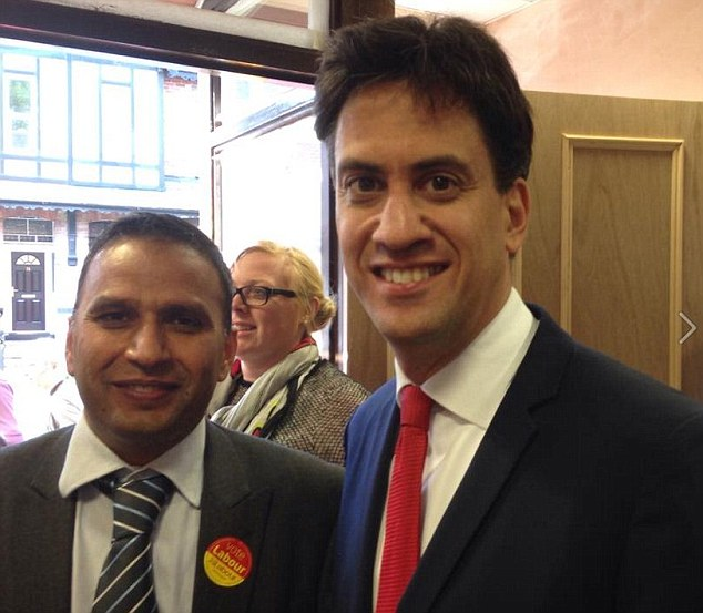 Rochdale Labour councillor Shakil Ahmed, pictured with Ed Miliband, whose sonwass caught trying to enter rebel-held Syria