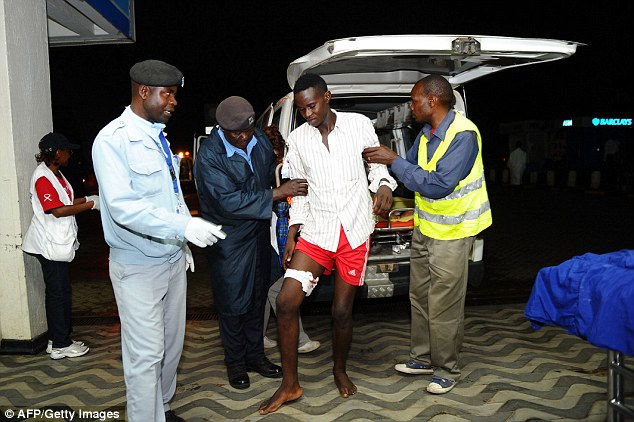 Wounded: A man with a leg injury arrived at hospital in Kenya's capital. The death toll has risen to 147