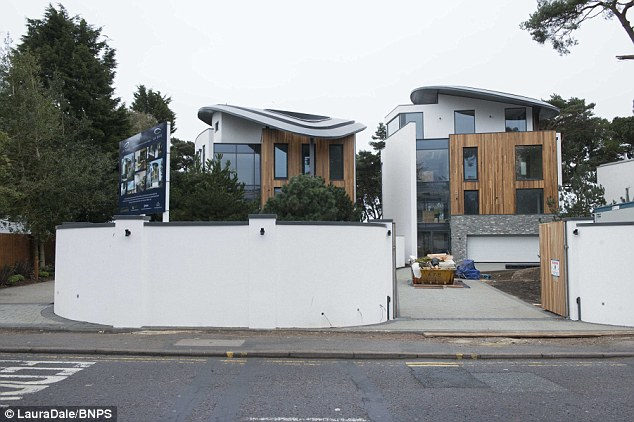Two adjoining 'his and hers' mansions have gone on the market on the world-renowned Sandbanks peninsula for £13 million
