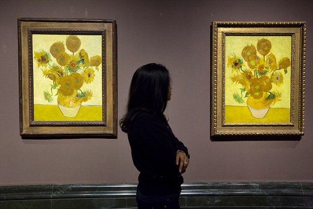 Two versions of Van Gogh's Sunflowers painting on show at the National Gallery in in London, England: Yellow and orange are the most popular colours in artworks from 1800, it has been found.