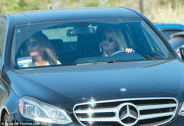 Out and about: Lara Bingle has been spotted out in public with her mother Sharon for the first time since she and Sam Worthington welcomed their son Rocket Zot into the world