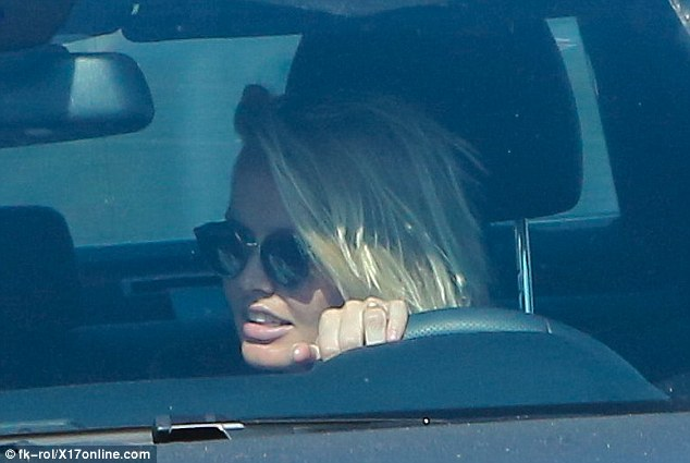 All smiles: Wearing her wedding ring and looking comfortable behind the wheel of her black Mercedes SUV, the new mother was glowing