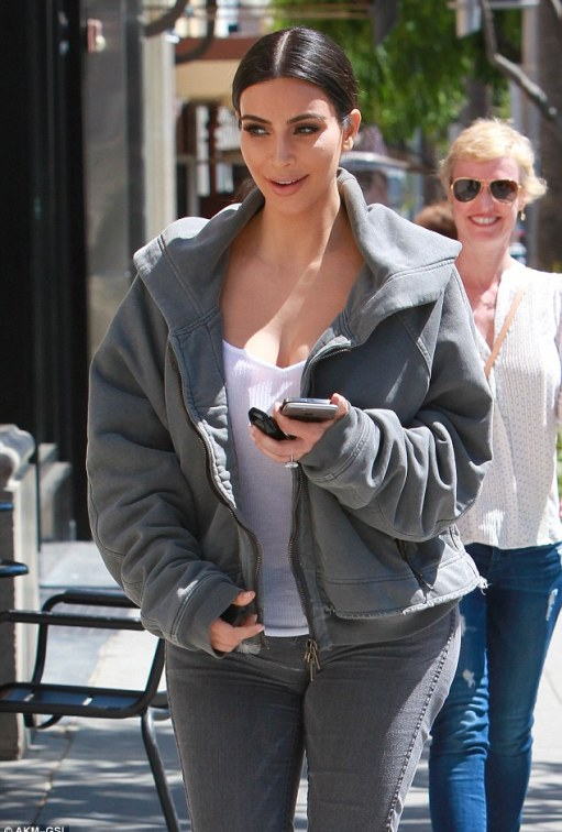 Comfort: Kim wore the hoodie with matching skinny jeans and a white vest