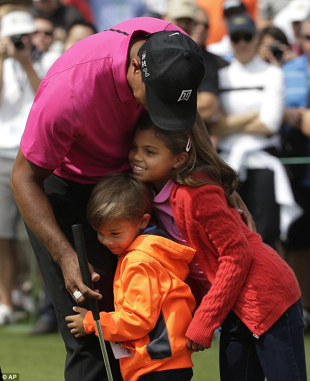 Woods, 39, was pictured hugging Sam, 8, and Charlie, 6, during the second day of practice at the Augusta National Golf Club ahead of his latest attempt at a comeback at The Masters 2015