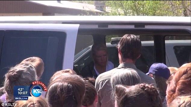 Sabrina Broadbent Tetzner mobbed inside her SUV