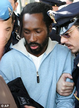 Convict: Small time drug dealer Rudy Guede, 29, is currently serving a 16-year sentence for the murder