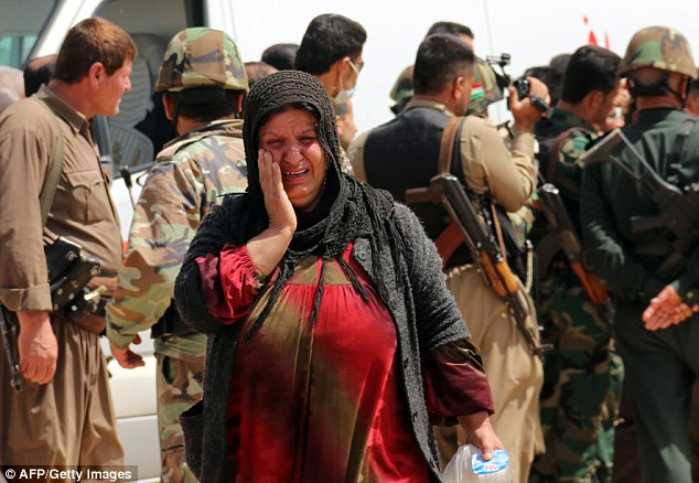 Relief: A newly released Yazidi woman reacts upon her arrival in the village of Himera, southwest of Kirkuk, after she and hundreds of other Yazidis had been held captive since last summer