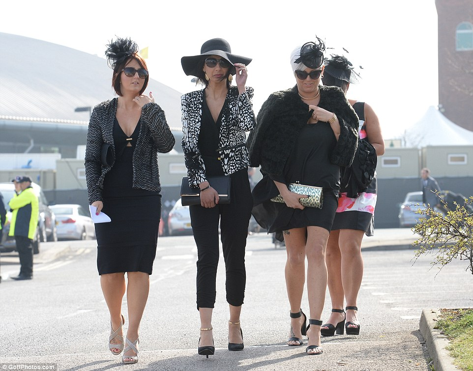 Mono mania: A quartet of ladies arrive dressed in chic all-black ensembles, with one, unusually, opting for trousers instead of the usual dress