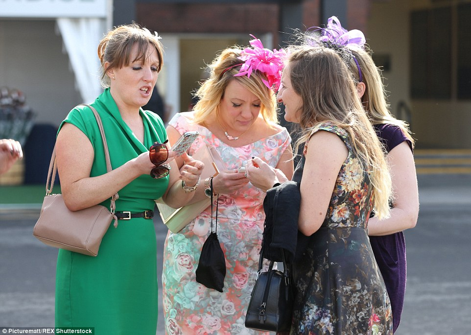 Place your bets! Some of the ladies appeared intent on checking the latest odds on their phones
