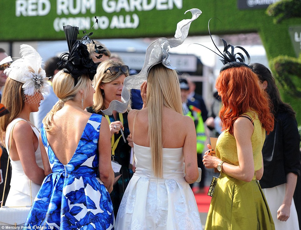 Comparing notes? A quintet of ladies enjoy a chat as they arrive for a day's racing at Aintree