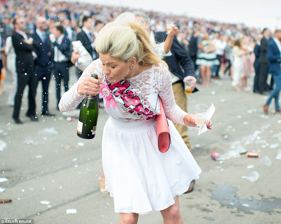 Oops! One lady's champagne swigging plans didn't quite go to plan and she ended up with booze splashed across her face