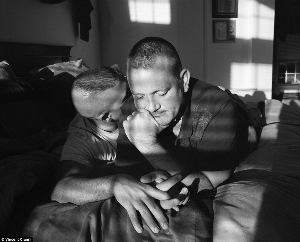 Togetherness: Matt McCary (right) was arrested in 2000 after being singled out by a fellow airman. He was discharged from the US Air Force within five days. David Cochenic (left) received Navy and Marine Corps Commendation Medal, and Navy and Marine Corps Achievement Medal. The two were photographed in Orange Park, Florida