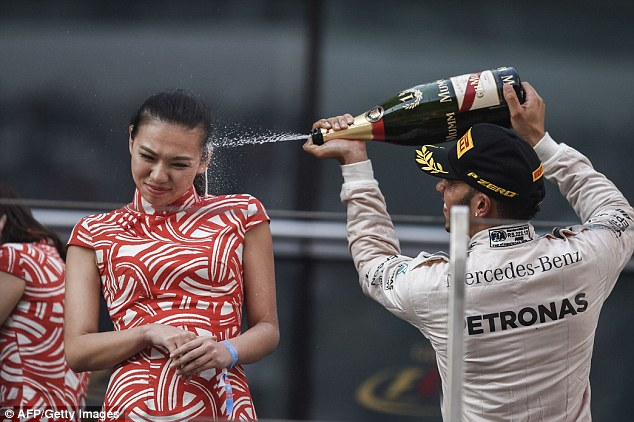 Liu Siying was pictured grimacing as Lewis Hamilton sprayed champagne at her face after winning the race