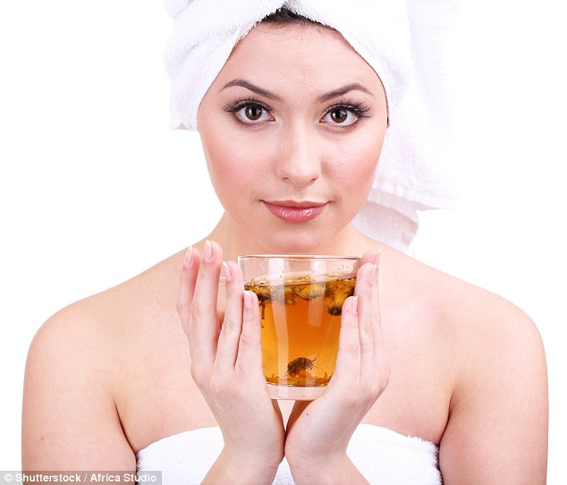 Steep three green teabags in boiling water, allow to cool and wash into your hair to lock in the shine (stock image)