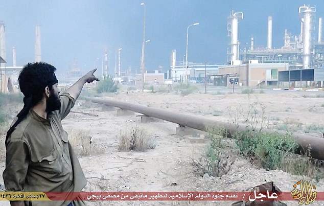 Newly published photos and a brief video shows dozens of ISIS fighters celebrating inside the oil fields facilities.