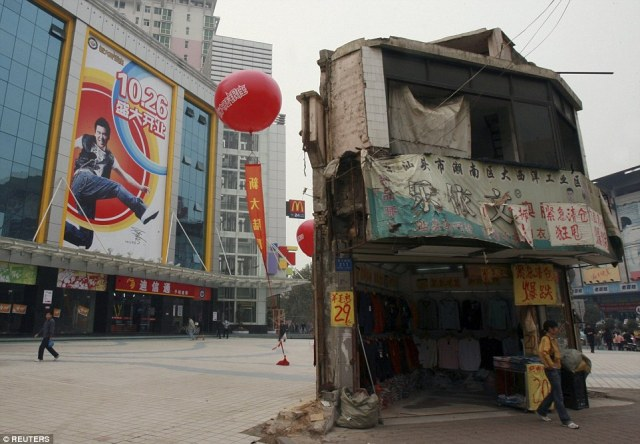 A nail house stands on the square in front of a shopping mall in Changsha, central China's Hunan province