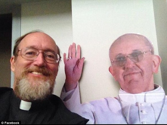 Edward Fride, pictured next to a cut-out of the Pope,warned that crime had gone up in the area while budget cuts meant that there had been a 'reduction in the availability of an armed police response'