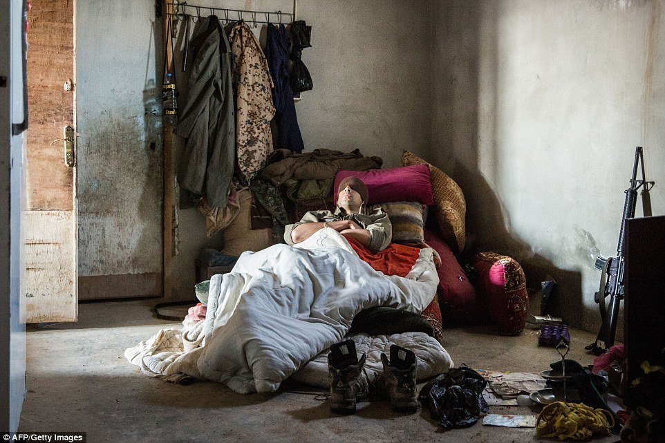 A 26-year old former US soldier nick-named Hewal Amed sleeps in an abandoned building  in the outskirts of the Syrian town of Tal Tamr