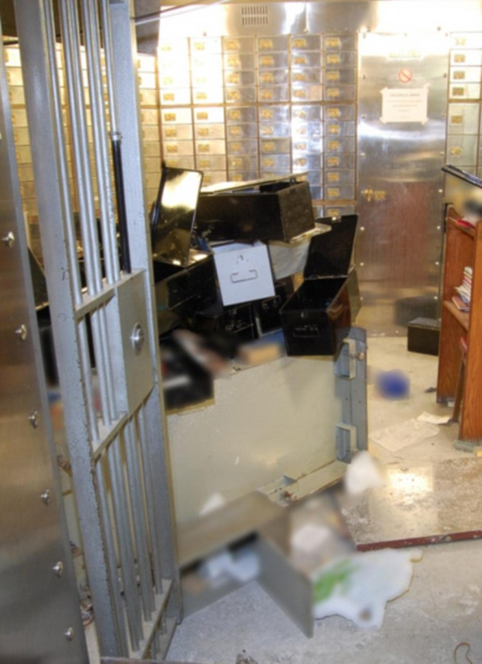 The images also show the vault's floor piled high with 72 ransacked safe deposit boxes after the robbery over the Easter Bank holiday weekend