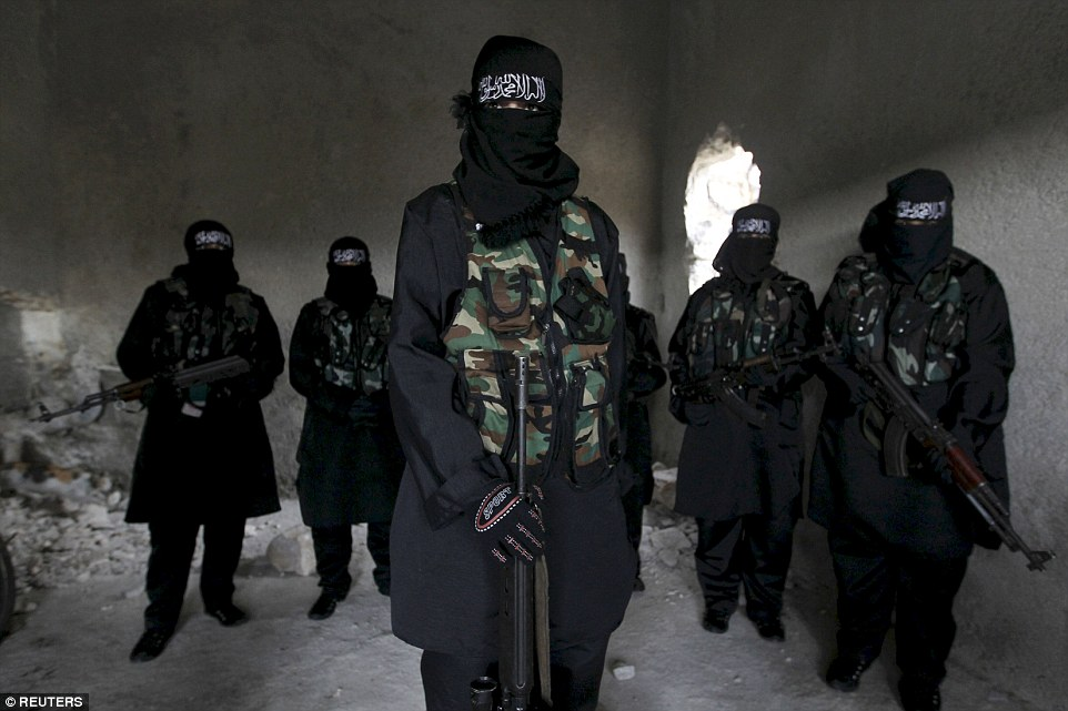 Ready for battle: Female members of the Sawt al-Haq (Voice of Rights) battalion of the Free Syrian Army stand with their weapons as they undergo military training in Aleppo in 2013