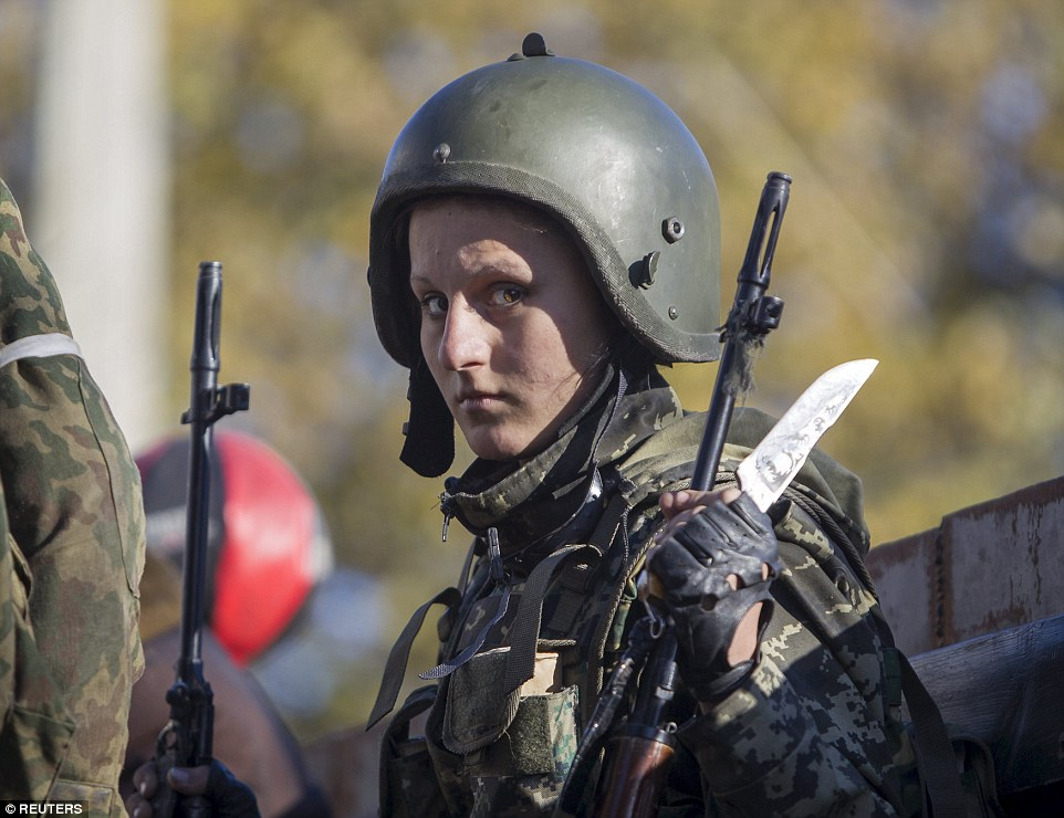 A female pro-Russian rebel stands on a truck as she prepares to take position near the Sergey Prokofiev International Airport during fighting with Ukrainian government forces in the town of Donetsk, eastern Ukraine in October 2014
