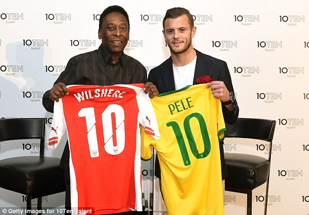 Brazil legend Pele (left) and Arsenal midfielder Jack Wilshere pose for a photo during launch of 10Ten Talent