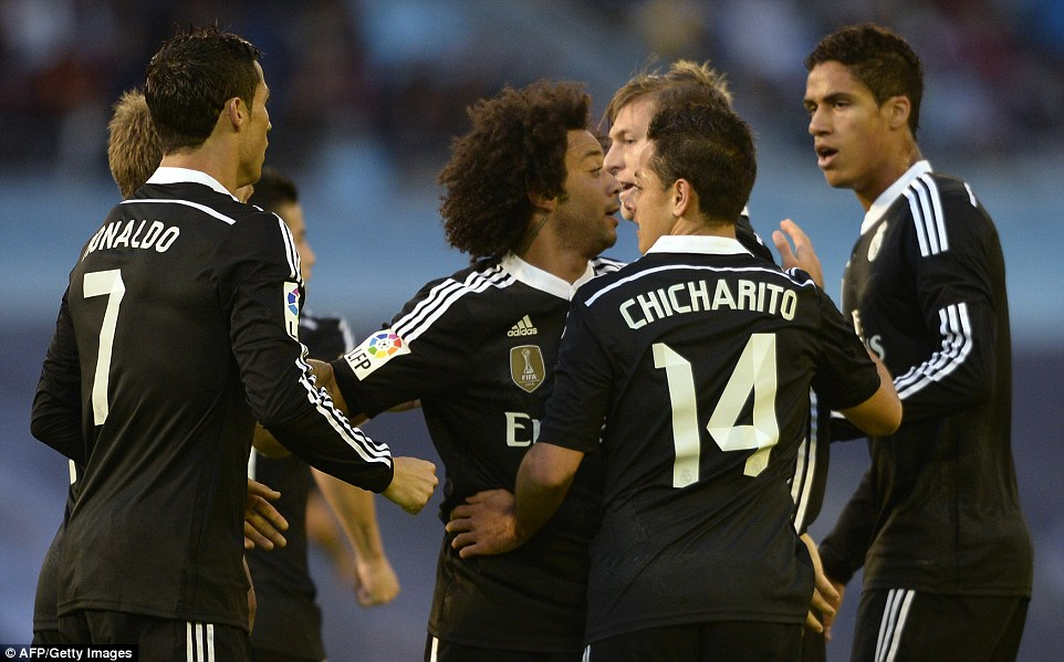 be54a1adf The Real Madrid players surround striker Hernandez (No 14) after his first  goal brought