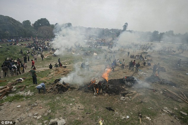 Tragic: The grieving Nepalese nation has begun the grim and daunting task of cremating the thousands of victims who were killed during Saturday's devastating earthquake. Above, the scene of a multi cremation