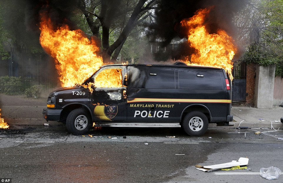 Police van ablaze: Television images showed mobs of rioters jumping on top of a police car, destroying a taxi and setting two other patrol cars on fire after teenaged crowds ignored calls to disperse and clashed with lines of hundreds of police. Gangs had threatened to target police officers, local law enforcement said