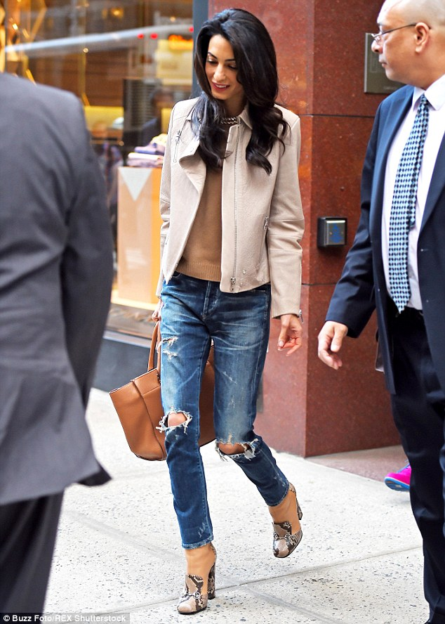Tattered: Amal edged up her ensemble with distressed denim skinny jeans