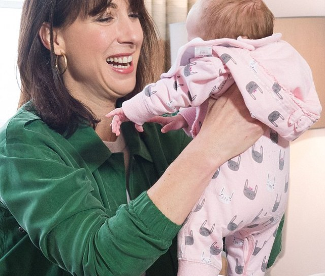 Smitten Mrs Cameron Looks Besotted With Seven Week Old Baby Regan During A