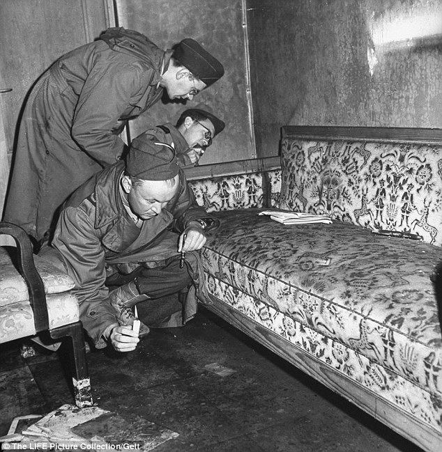 Proof?: This picture, taken by William Vandivert, the first Western photographer allowed into the bunker, shows blood on the edge of the sofa in Adolf Hitler's sitting room in his secret bunker