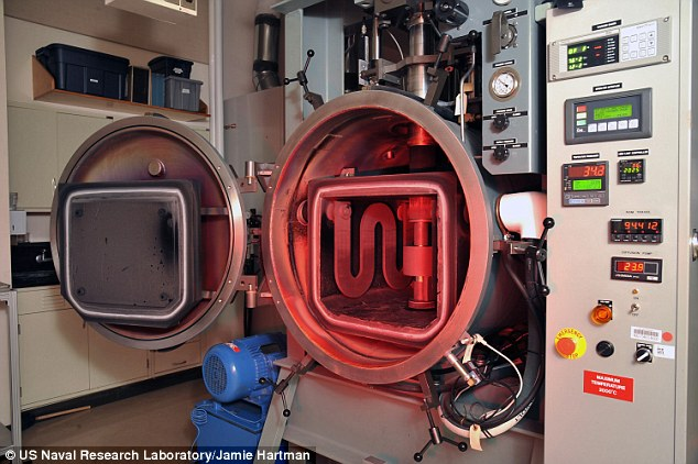 Researchers at the US Naval Research Laboratory have synthesised their own ultra-pure spinel powder which they can form into sheets of crystal using a process called 'sintering' in a hot press (pictured)