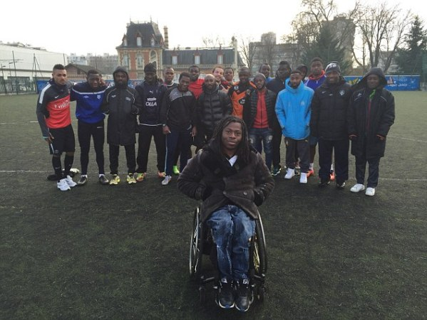 Reporter Ade Adepitan with African footballers who've been stranded in Paris by unscrupulous agents