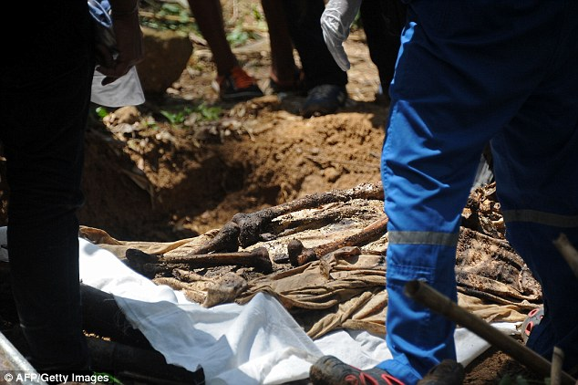Remains: The site where corpses and bones (pictured) are currently being dug up was a known stop-off for traffickers before taking the refugees across the border and beyond