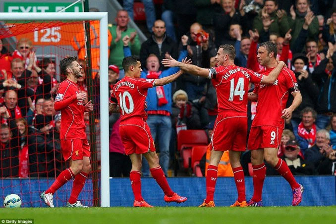 Coutinho (second left) celebrates with Jordan Henderson (second right), Lambert (right) and Adam Lallana (left)