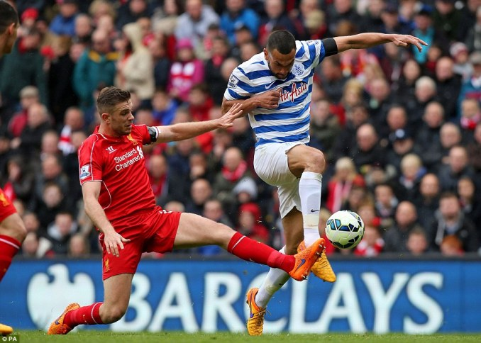 Liverpool vice-captain Henderson (left) challenges Steven Caulker, who was taken off at half-time with a suspected broken hand