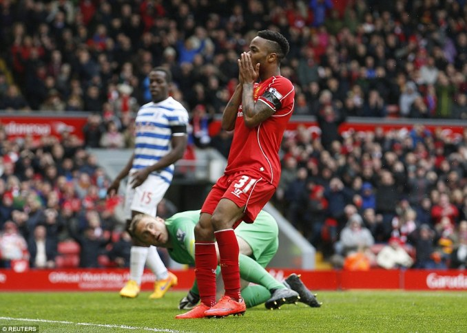 Raheem Sterling reacts after missing a golden chance to double Liverpool's lead from close range in the second half