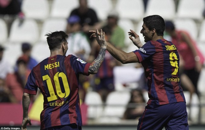 Messi (left) runs over to congratulate Suarez (right) after scoring during the 8-0 win over Cordobaat the Nuevo Arcangel Stadium